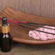 Aromatherapy setting on brown bamboo background - Photo