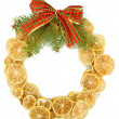 Christmas wreath of dried lemons with fir tree and bow isolated on white — Stok fotoğraf