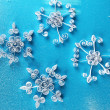 Stock Photo: Beautiful paper snowflakes, on blue background
