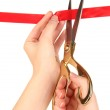 Cutting red ribbon isolated on white — Stock Photo #17683145