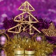 Christmas composition with candles and decorations in purple and gold colors on bright background — Stock Photo #17683349