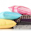 Plaids and color pillows, isolated on white — Stock Photo #17683689