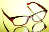 Beautiful glasses on green background — Stock Photo