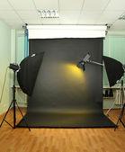 Empty photo studio with lighting equipment — ストック写真