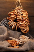 Tasty bagels and spikelets on wooden background — Stock Photo