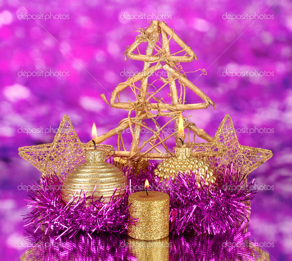 Christmas composition  with candles and decorations in purple and gold colors on bright background  Stock Photo #17683335