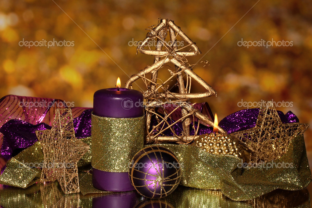 Christmas composition  with candles and decorations in purple and gold colors — Stock Photo #17683353