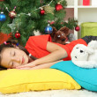 Royalty-Free Stock Photo: Little girl sleeping near christmas tree
