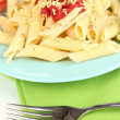 Stock Photo: Rigatoni pastdish with tomato sauce close up
