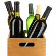 Wine bottles in wooden box isolated on white — Stock Photo #17845157