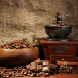 Coffee grinder and cup of coffee on burlap background — Lizenzfreies Foto