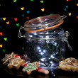 Christmas lights in glass bottle on blur lights background — Foto de Stock