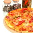 Tasty pepperoni pizza with vegetables on wooden board close-up — Stock Photo