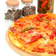 Tasty pepperoni pizza with vegetables on wooden board close-up - Stock Photo