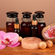 Stock Photo: Ingredients for soap making on brown background