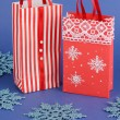 Christmas paper bags for gifts on blue background — Foto Stock