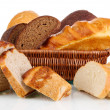 Fresh bread in basket isolated on white - Stock Photo