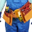 Male builder in blue overalls with saw isolated on white — Stock Photo