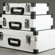 Stock Photo: Silvery suitcases on grey background