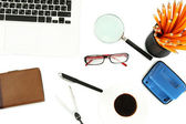 Office supply and laptop isolated on white — Stock Photo
