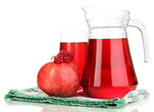 Full glass and jug of pomegranate juice and pomegranate isolated on white — Stock Photo
