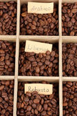 Coffee beans in wooden box close-up — Stock Photo