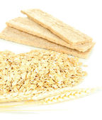 Oat flakes pile with spikelets and oat biscuits isolated on white — Stock Photo