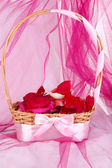Wedding basket with rose petals — Stock Photo