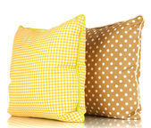 Yellow and brown bright pillows isolated on white — Stock Photo