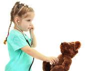 Little girl doctor with toy bear, isolated on white — Stock Photo