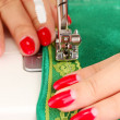 Hand sewing on  machine - Stock Photo