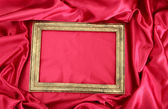 Empty frame on beautiful silk — Stock Photo