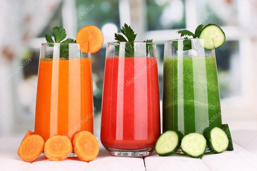 Fresh vegetable juices on wooden table, on window background — Stock Photo #17873581