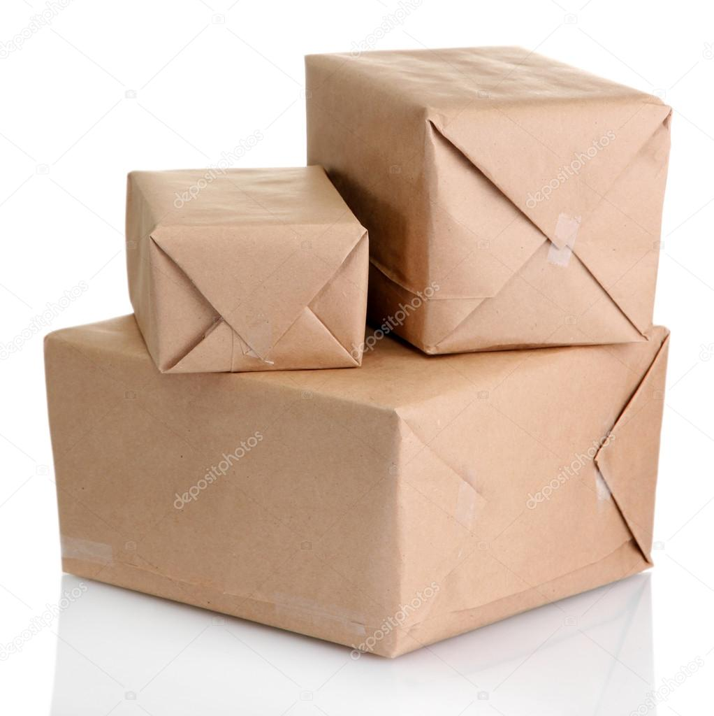 Parcels boxes with kraft paper, isolated on white  Stock Photo #17873711