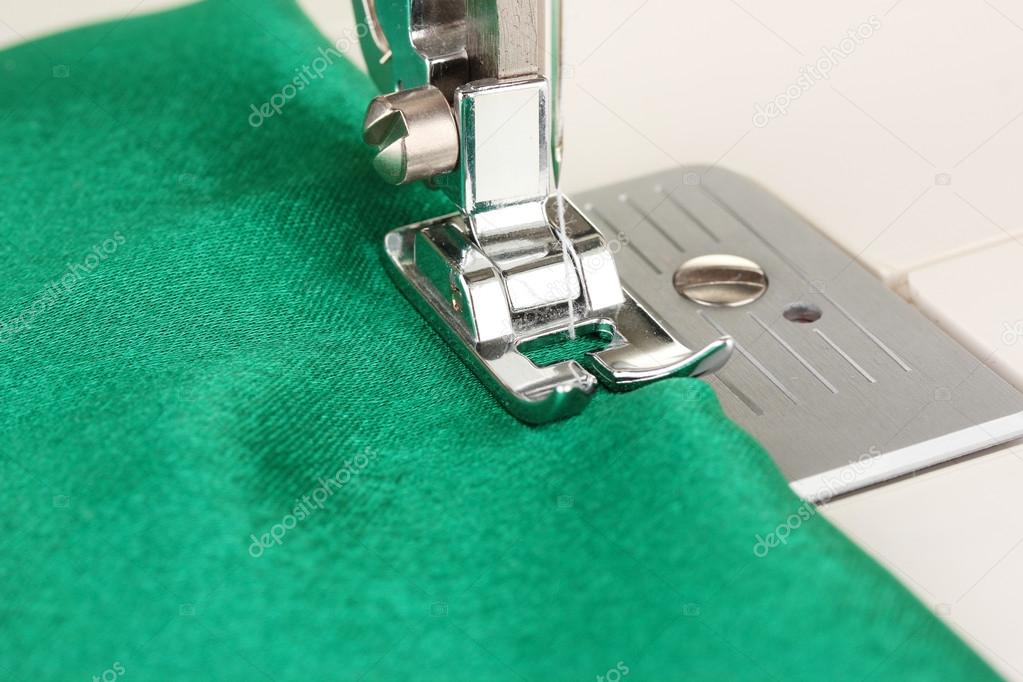 Closeup of sewing machine working part with  green cloth — Stock Photo #17873731