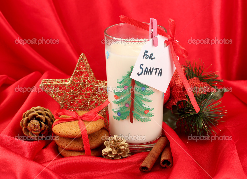 Cookies for Santa: Conceptual image of ginger cookies, milk and christmas decoration on red background — Stock Photo #17873919