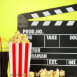 Movie clapperboard, cola and popcorn on background - Stok fotoğraf