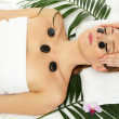 Portrait of beautiful woman with spa stones taking head massage — Stock Photo #17992087