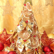 Beautiful christmas tree of dry lemons with decor, on yellow background - Foto de Stock
