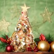Beautiful christmas tree of dry lemons with decor, on grey background - Стоковая фотография