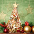 Beautiful christmas tree of dry lemons with decor, on grey background - Stock Photo
