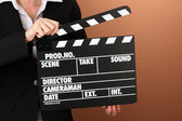 Movie production clapper board on color background — Stockfoto