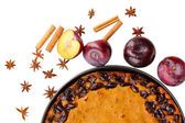 Tasty pie on pan with plums and cinnamon isolated on white — Stock Photo