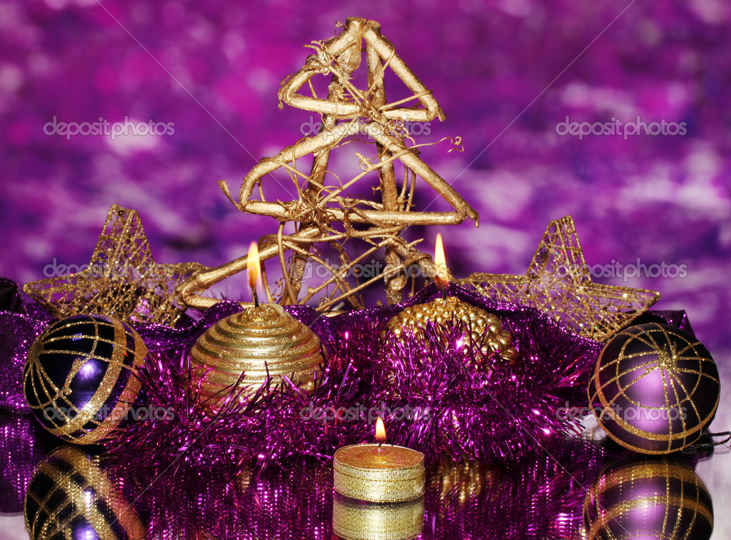 Christmas composition  with candles and decorations in purple and gold colors on bright background  Stock Photo #17992103