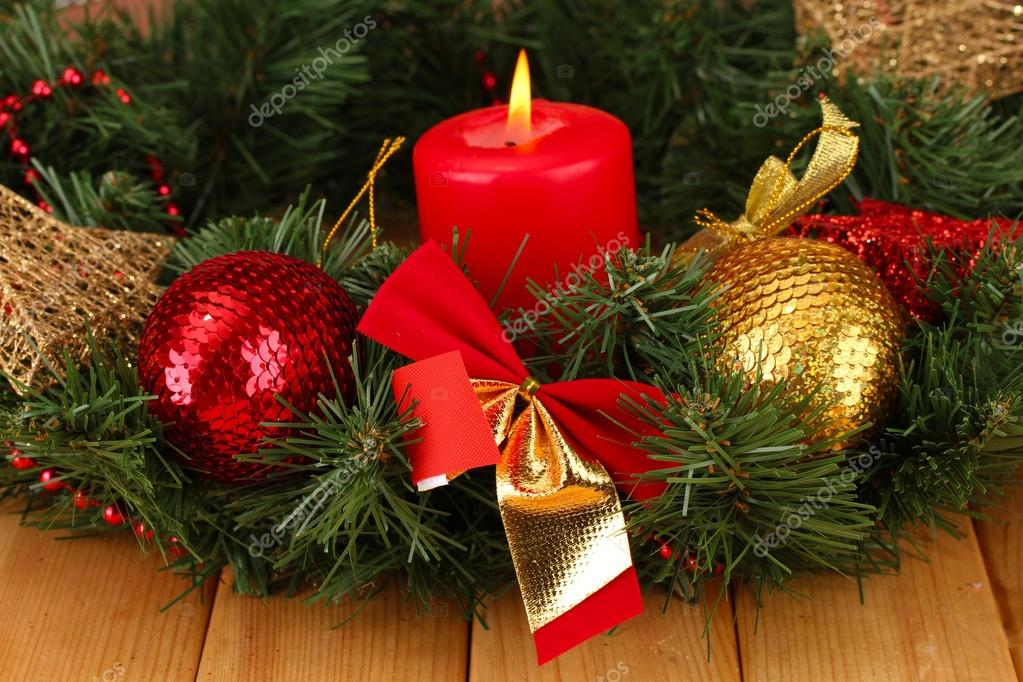 Christmas composition  with candle and decorations in red and gold colors on wooden background — Stock Photo #17992111
