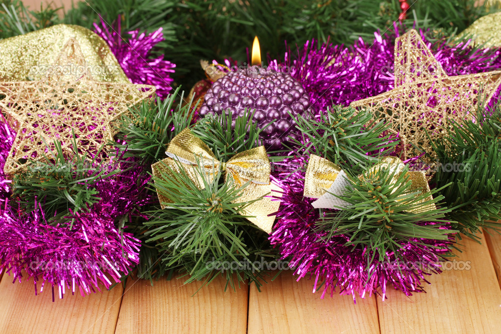 Christmas composition  with candles and decorations in purple and gold colors on wooden background — Stock Photo #17992115