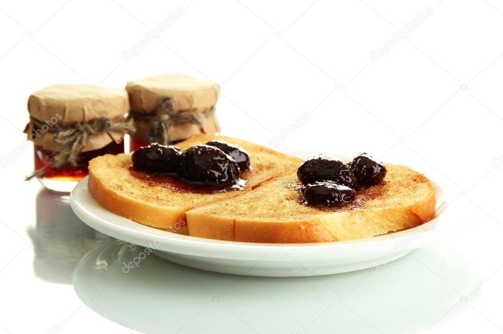 White bread toast with jam on plate, isolated on white — Stock Photo #17992133