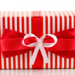 Colorful red gift with bow isolated on white — Stock Photo