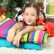 Little girl dreaming near christmas tree — Stock Photo #18038463