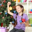 Little girl decorating christmas tree — Stok Fotoğraf #18038501